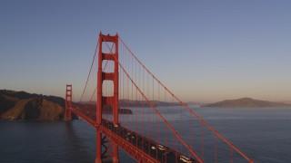 DFKSF10_028 - 5K stock footage aerial video of ascending over the Golden Gate Bridge, San Francisco, California, sunset