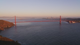DFKSF10_035 - 5K stock footage aerial video of flying over Marin Hills, reveal Golden Gate Bridge in San Francisco, California, sunset