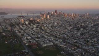 DFKSF10_044 - 5K stock footage aerial video of approaching Russian Hill and Downtown San Francisco skyscrapers, California, sunset