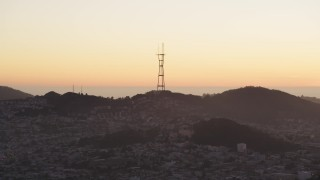 DFKSF10_057 - 5K stock footage aerial video of a view of Sutro Tower from Downtown San Francisco, California, sunset