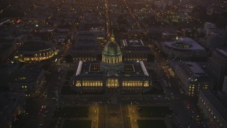 DFKSF10_079 - 5K stock footage aerial video of an approach to San Francisco City Hall in Civic Center, San Francisco, California, twilight