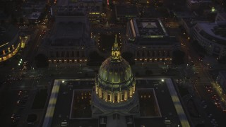 DFKSF10_080 - 5K stock footage aerial video approach city hall in Civic Center, tilt to opera house and theater, San Francisco, California, twilight