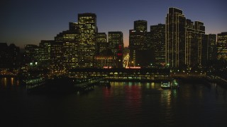 DFKSF10_093 - 5K stock footage aerial video of the Ferry Building and skyline of Downtown San Francisco, California, night