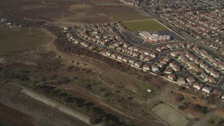 DFKSF11_003 - 5K stock footage aerial video of flying away from suburban tract homes, Union City, California