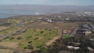 DFKSF11_018 - 5K stock footage aerial video pan from golf course to reveal Googleplex office buildings, Mountain View, California