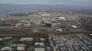 DFKSF11_019 - 5K stock footage aerial video of flying by Moffett Field and NASA Ames Research Center, Mountain View, California