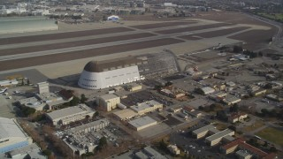 DFKSF11_020 - 5K stock footage aerial video tilt from NASA Ames Research Center, reveal Hangar One at Moffett Field, Mountain View, California