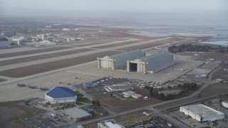 DFKSF11_024 - 5K stock footage aerial video of Hangars 2 and 3 at Moffett Field, Mountain View, California
