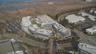DFKSF11_026 - 5K stock footage aerial video of flying away from Yahoo! Campus office buildings in Sunnyvale, California