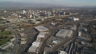 DFKSF12_001 - 5K stock footage aerial video fly over train tracks and yard, tilt to reveal Downtown San Jose, California