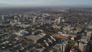 DFKSF12_002 - 5K stock footage aerial video of flying by San Jose State University and Downtown San Jose, California
