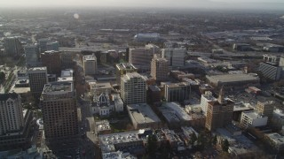 DFKSF12_004 - 5K stock footage aerial video follow West San Fernando Street past office buildings to Highway 87, Downtown San Jose, California