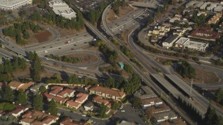 DFKSF12_009 - 5K stock footage aerial video of a reverse view of the I-280 freeway interchange and tract homes, San Jose, California