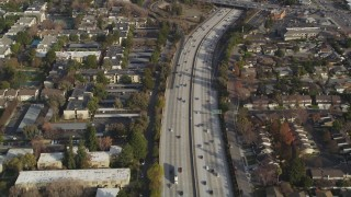 DFKSF12_011 - 5K stock footage aerial video of a reverse view of I-280 freeway with light traffic, San Jose, California