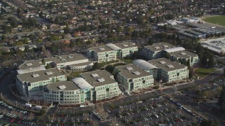 DFKSF12_014 - 5K stock footage aerial video of an orbit of Apple Headquarters office buildings, Cupertino, California
