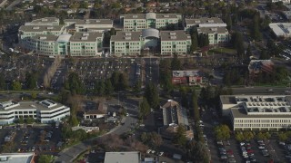 DFKSF12_017 - 5K stock footage aerial video tilt from Valley Green Drive revealing Apple Headquarters office buildings, Cupertino, California