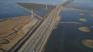 DFKSF12_031 - 5K stock footage aerial video of flying over Highway 84 freeway, revealing Dumbarton Bridge, Menlo Park, California