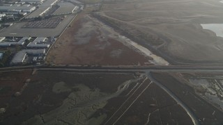 DFKSF12_039 - 5K stock footage aerial video of a reverse view of marshland, Hayward, California