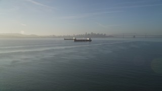 DFKSF13_001 - 5K stock footage aerial video of approaching oil tankers in San Francisco Bay, San Francisco, California