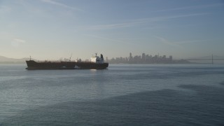 DFKSF13_003 - 5K stock footage aerial video of an approach to an oil tanker on San Francisco Bay, San Francisco, California