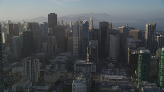 DFKSF13_013 - 5K stock footage aerial video of tilting from South of Market, revealing Downtown San Francisco skyscrapers, California