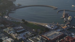 DFKSF13_031 - 5K stock footage aerial video of flying over historic ships at Hyde Street Pier, Russian Hill, San Francisco, California