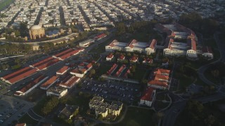 DFKSF13_039 - 5K stock footage aerial video fly over film studio at The Presidio, reveal distant skyline of Downtown San Francisco, California