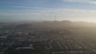 DFKSF13_040 - 5K stock footage aerial video of approaching Sutro Tower, shrouded in haze in San Francisco, California