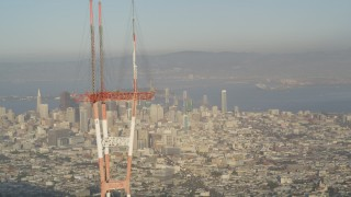 DFKSF13_045 - 5K stock footage aerial video of orbiting top of Sutro Tower, revealing Downtown San Francisco, California