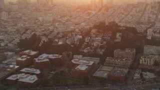 DFKSF14_019 - 5K stock footage aerial video of flying by iconic Coit Tower in North Beach, San Francisco, California, sunset