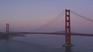 DFKSF14_030 - 5K stock footage aerial video of panning across the famous Golden Gate Bridge, San Francisco, California, twilight