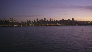 DFKSF14_059 - 5K stock footage aerial video of Russian Hill, Coit Tower and Fisherman's Wharf, San Francisco, California, twilight
