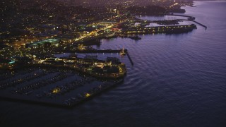 DFKSF14_060 - 5K stock footage aerial video of flying away from Pier 39. and Fisherman's Wharf in San Francisco, California, twilight