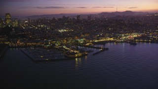 DFKSF14_061 - 5K stock footage aerial video of flying by Pier 39 and Fisherman's Wharf, San Francisco, California, twilight