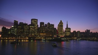 DFKSF14_065 - 5K aerial stock footage video of Downtown San Francisco skyscrapers and Ferry Building, California, twilight