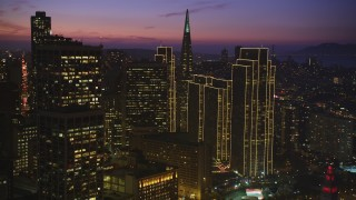DFKSF14_070 - 5K stock footage aerial video pan across skyscrapers near Transamerica Pyramid in Downtown San Francisco, California, twilight
