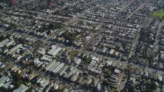 DFKSF15_001 - 5K stock footage aerial video of a reverse view of suburban neighborhoods, Alameda, California