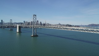 DFKSF15_006 - 5K stock footage aerial video of approaching the Bay Bridge, with views of Downtown San Francisco skyline, California