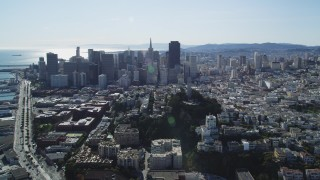 DFKSF15_017 - 5K stock footage aerial video of the Transamerica Pyramid, skyscrapers and Coit Tower, Downtown San Francisco, California