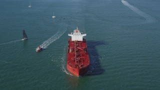 DFKSF15_020 - 5K stock footage aerial video of flying over oil tanker sailing San Francisco Bay, San Francisco, California