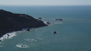 DFKSF15_038 - 5K stock footage aerial video of flying by coastal cliffs while approaching Seal Rocks, San Francisco, California