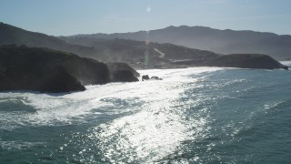 DFKSF15_052 - 5K stock footage aerial video of tilting from the ocean revealing coastal homes, Pacifica, California