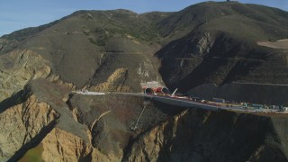 DFKSF15_059 - 5K stock footage aerial video of flying by Highway 1 along coast and a tunnel under construction, Pacifica, California