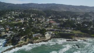 DFKSF15_066 - 5K aerial stock footage video of flying by coastal neighborhoods in Moss Beach, California