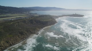 DFKSF15_067 - 5K stock footage aerial video pan from Half Moon Bay Airport to Pillar Point Air Force Station, Half Moon Bay, California