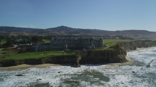 DFKSF15_074 - 5K stock footage aerial video of flying by an oceanfront hotel on coastal cliffs, Half Moon Bay, California