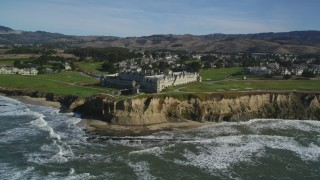 DFKSF15_076 - 5K stock footage aerial video of flying away from The Ritz Carlton hotel on coastal cliffs, Half Moon Bay, California