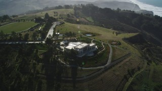 DFKSF15_086 - 5K stock footage aerial video approach an isolated mansion on a hilltop near the coast, San Gregorio, California