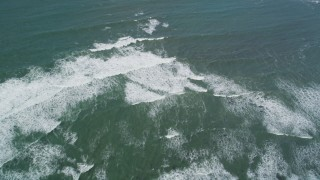 DFKSF15_100 - 5K stock footage aerial video of a reverse view of ocean waves near the coast, Pescadero, California