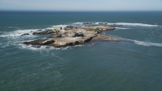 DFKSF15_103 - 5K stock footage aerial video of tilting from the ocean revealing Año Nuevo Island, California